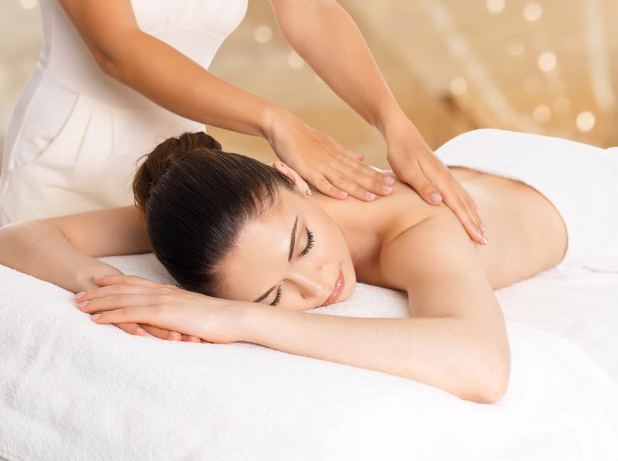 Woman having massage of body in the spa salon. Beauty treatment